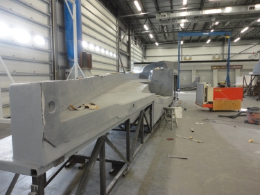 Shop shot. Final sanding of the Class 40 deck before delivery to COY